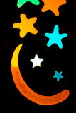 Wood grunge stars background. Black background with colorful stars and the moon Stock Image