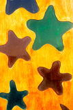 Wood grunge stars background. Yellow vintage wood background with colorful stars Royalty Free Stock Photography