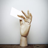 Wood hand holding blank business card Royalty Free Stock Image