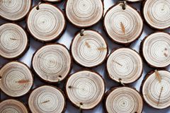 Wood handmade medals with linen twine. Natural wood handmade medals with linen twine. Stack of wooden homemade medals on white background. Round wood slices Stock Photos