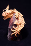 Wood Handmade Statuette of a Dragon Royalty Free Stock Image