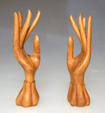 Wood hands 3. Esculptures of wood hands with neutral back Stock Image