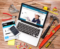 Wood handyman's desk in high definition with laptop, tablet and Royalty Free Stock Photos