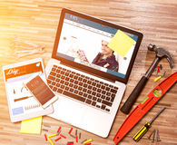Wood handyman's desk in high definition with laptop, tablet and Royalty Free Stock Image