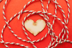 Wood heart with gift ribbon Stock Image