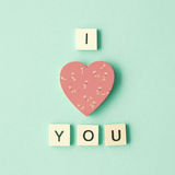 Wood Heart and love message. Vintage hand-painted wood heart with love message Royalty Free Stock Image