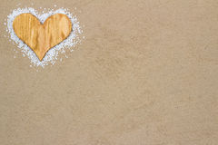 Wood Heart in the sand. Handmade wood heart in the sand with copy space Stock Photography