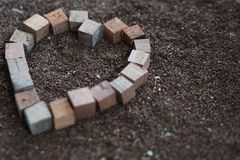 Wood heart squar boxes on the saw dust 2 Stock Photos