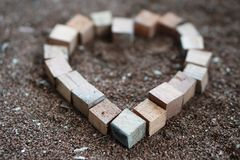 Wood heart squar boxes on the saw dust 3 Stock Image