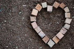 Wood heart squar boxes on the saw dust 4 Royalty Free Stock Photo