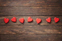 Wood Love Hearts Background. Heart shapes on a rustic wood background Stock Photo