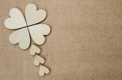 Wood hearts on hessian texture background Royalty Free Stock Photos