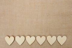 Wood hearts on hessian texture background, valentine background Stock Photos