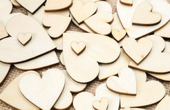 Wood hearts on hessian texture background, valentine background Stock Images