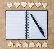 Wood hearts on hessian texture background, valentine background. Stock Image