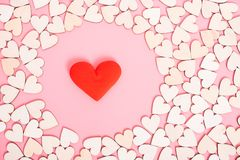 Wood hearts on pink background have a gift box royalty free stock image