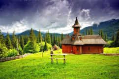 Isolated wooden church in the mountain  Royalty Free Stock Photography
