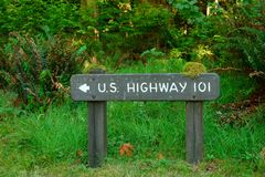 Wood Highway 101 sign in forest Stock Photography