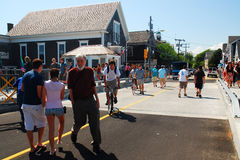 Wood Hole in the Summer. A crowd walks across a recently closed draw bridge in Woods Hole Cape Cod Stock Image