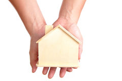 Wood Home in the hand Royalty Free Stock Photography