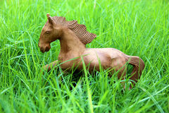 Wood horse on grass field Royalty Free Stock Photos