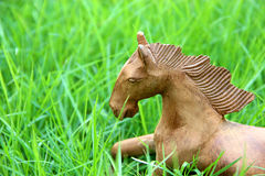 Wood horse on grass field Stock Photography