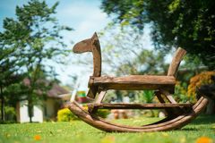 Wooden horse in the field royalty free stock photography