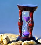 Wood hourglass  on blue background Royalty Free Stock Photos
