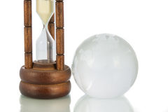 Wood hourglass countdown isolate and the globe Stock Photo