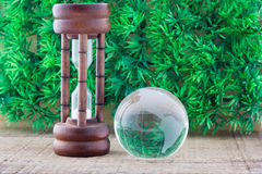 Wood hourglass countdown start and the globe Stock Photo