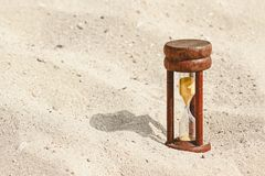 Wood hourglass on sandy beach Stock Photography