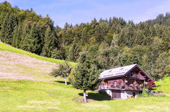 Wood house in the Alps mountains Royalty Free Stock Photo