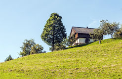 Wood house in the Alps mountains Royalty Free Stock Image