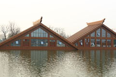 Wood house built on water Royalty Free Stock Images