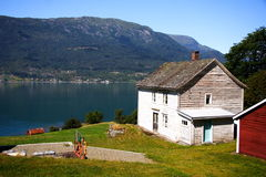 Wood house on fjord Royalty Free Stock Photos