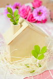 Wood house and green plant Stock Photography