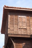 Wood House. Historic wood house with shutters and roof tiles Royalty Free Stock Image