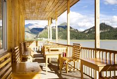 Wood house in lake near mountain Royalty Free Stock Photo
