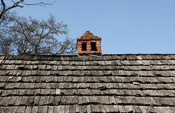 Wood house roof chimney stock image