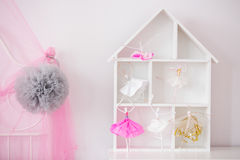 Wood house shelf for child. Room and pink canopy royalty free stock photo