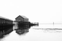 Wood house on stilts at edge of pier at plant on Pacific coast i Royalty Free Stock Photography