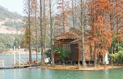 Wood house on water Royalty Free Stock Photos