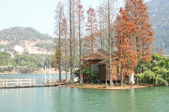 Wood house on water Royalty Free Stock Image