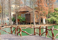 Wood house on water Royalty Free Stock Images