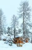 Wood house in winter misty mountain Stock Photo