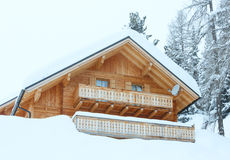 Wood house in winter misty mountain Stock Image