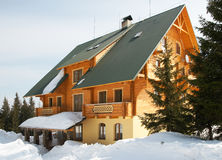 Wood house on winter mountainside Stock Photo