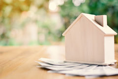 Free Wood House With Dollar Money On Table Tree Bokeh Background Royalty Free Stock Photo - 98183055
