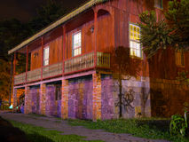 Wood house. Wooden house through the night stone base - Built by Italian immigrants, this century-old house is preserved in Gramado and historical heritage Royalty Free Stock Images