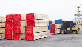 Wood industry. Timber wood piles deposit for export Stock Images